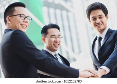 Three Businessmen Shaking hand together