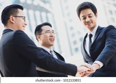 Three Businessmen Shaking hands together