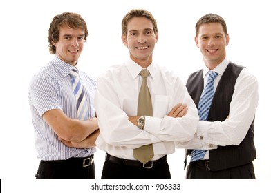Three businessmen stand with arms folded (shallow depth of field used)