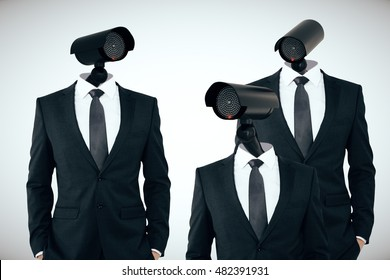Three businessmen in suits with CCTV cameras instead of heads on light background. Business/organization security management concept