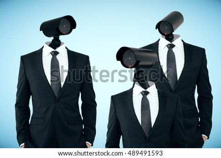 Three businessmen in suits with CCTV cameras instead of heads on light blue background. Business/organization security management concept
