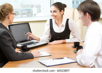 Three businesspeople looking at camera