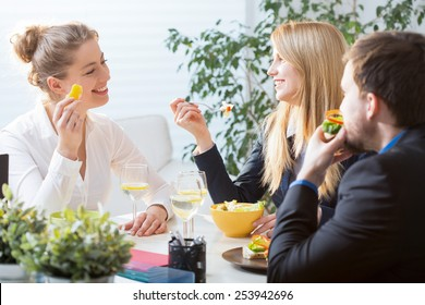 Three businesspeople on their brunch during conference
