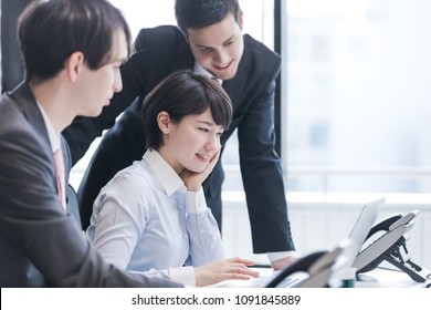 Three businessperson working in the office. Teamwork of business concept.