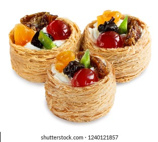 three cakes with fruits in a basket of dough kataifi isolated on white background