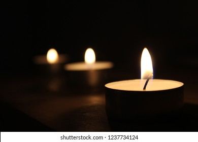 three candles with blurred background