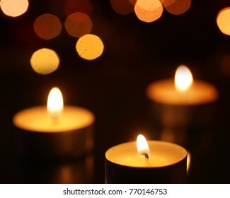 Three candles with bokeh spots