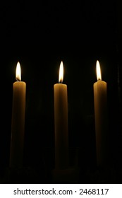Three candles in the dark of the night.