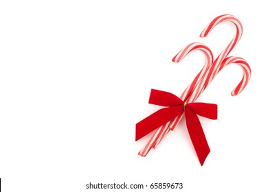 Three candy canes on a white background, candy cane background