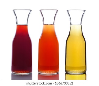 Three Carafes of wine - one red and one white and one blush or rose, isolated on white.