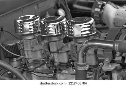 Three carburetors and intake manifold.