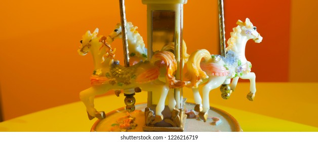 Three carillon horses on orange background