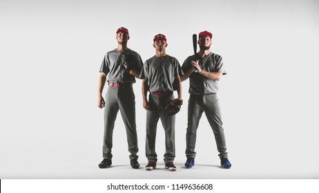 Three Caucasian professional baseball players posing against white background