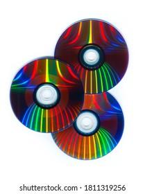Three CDs / DVDs on a white background, Computer information storage technology.