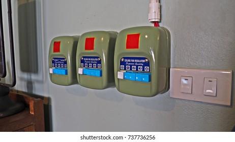 Three Ceiling fan regulators  on the wall to control the fan speed.