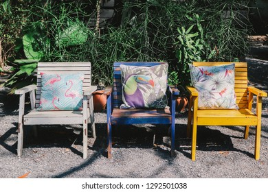 three chairs and pillow