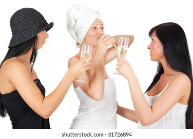 Three cheerful girls drinking champagne while smiling to each other having fun