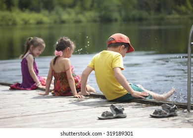 Three cheerful kids playing on the lake