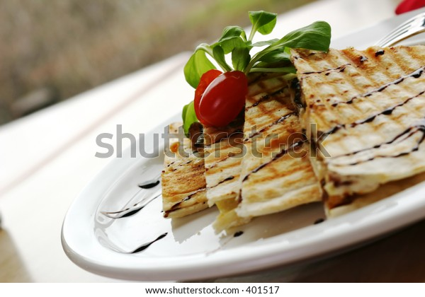 Three cheese chicken quesadilla, drizzeled with balsamic vinager. Shallow DOF