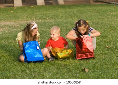Three children with gift bags