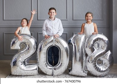 three children with large numbers 2018