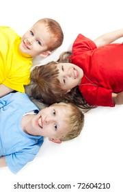 Three children lying on a white background