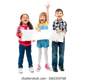 three children with open mouths holding empty sheet of paper