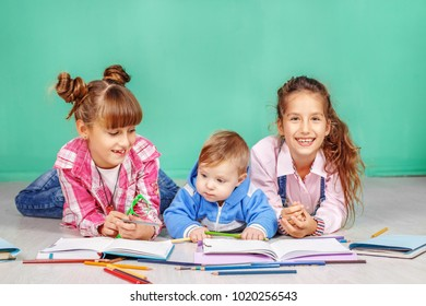 Three children read books. The concept of childhood, learning, friendship, family, school, lifestyle.