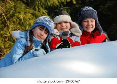 Three children in snow