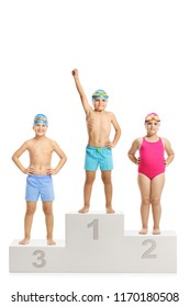 Three children in swimming suits on a winner's pedestal for first second and third placeisolated on white background