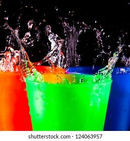 Three Children's multicolored plastic cups with splashes