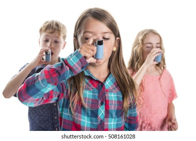three childs using inhaler for asthma. White background studio picture.