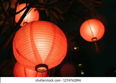 Three Chinese Lanterns at night