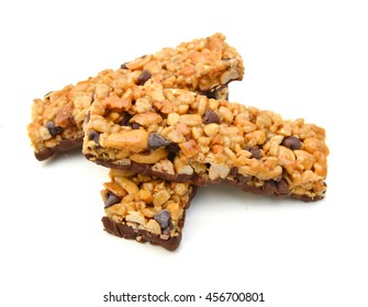 Three chocolate chip with peanuts protein bars isolated on a white background.