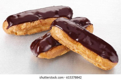 THREE CHOCOLATE ECLAIRS