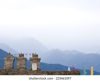 The three chortens with large prayer flags at Sikkims ancient capitol Rabdentse (India) in the Himalayan mountains