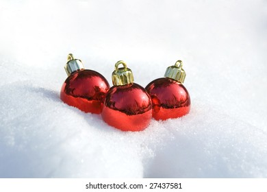Three christmas balls on the snow