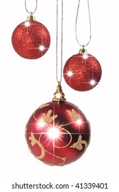 Three christmas baubles hanging against white background
