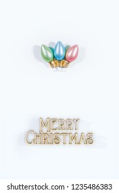 Three Christmas bulb ornaments on a white background with Merry Christmas text.  Lots of white space.