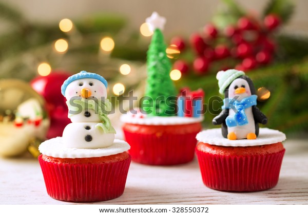 Three christmas cupcakes with tradition background