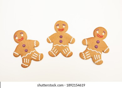Three Christmas gingerbread on white background