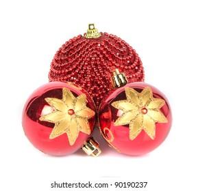 three Christmas glass toys on white background