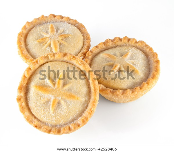 Three Christmas mince pies on a white background