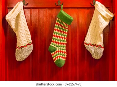 Three Christmas Stocking Hanging on Hooks