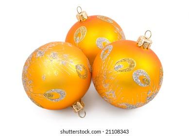 Three Christmas-tree toys on the white background