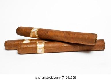 three cigars on white background