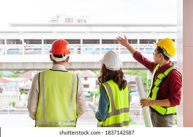 Three Civil engineers team with one female is discussing about transporation construction site