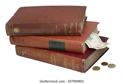 Three Classical Books on the Economy with banknote and currencies. Isolated