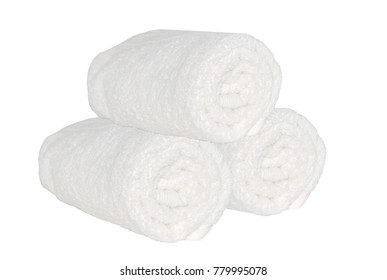 Three clean spa towels rolls on the white isolated backgtound