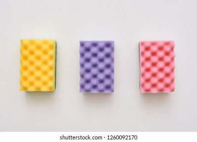 Three cleaning sponges isolated. Yellow,pink and purple cleaning sponges